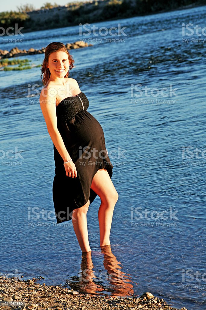 Pregnant at the River's Edge stock photo