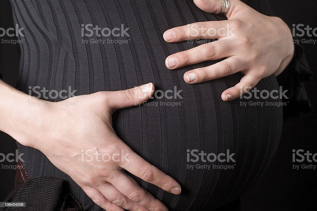 Pregnant belly stock photo
