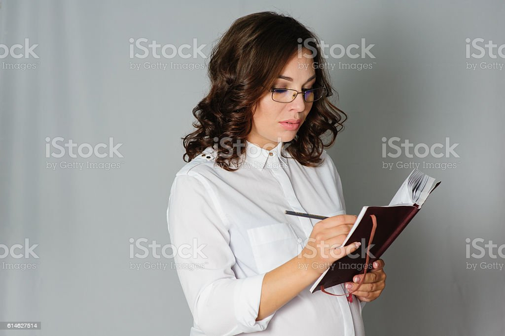 Pregnant business woman comes up with an idea stock photo