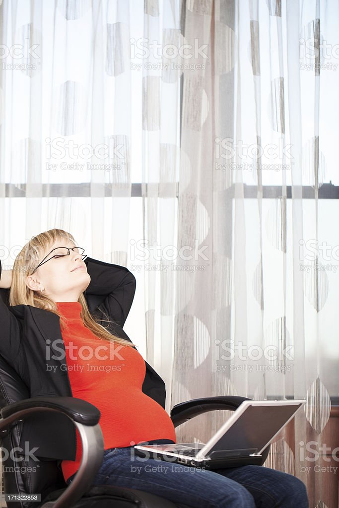Pregnant business woman resting stock photo