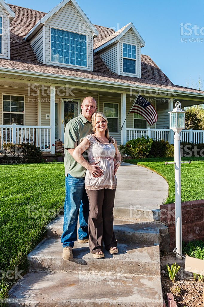 Pregnant Couple at Home stock photo