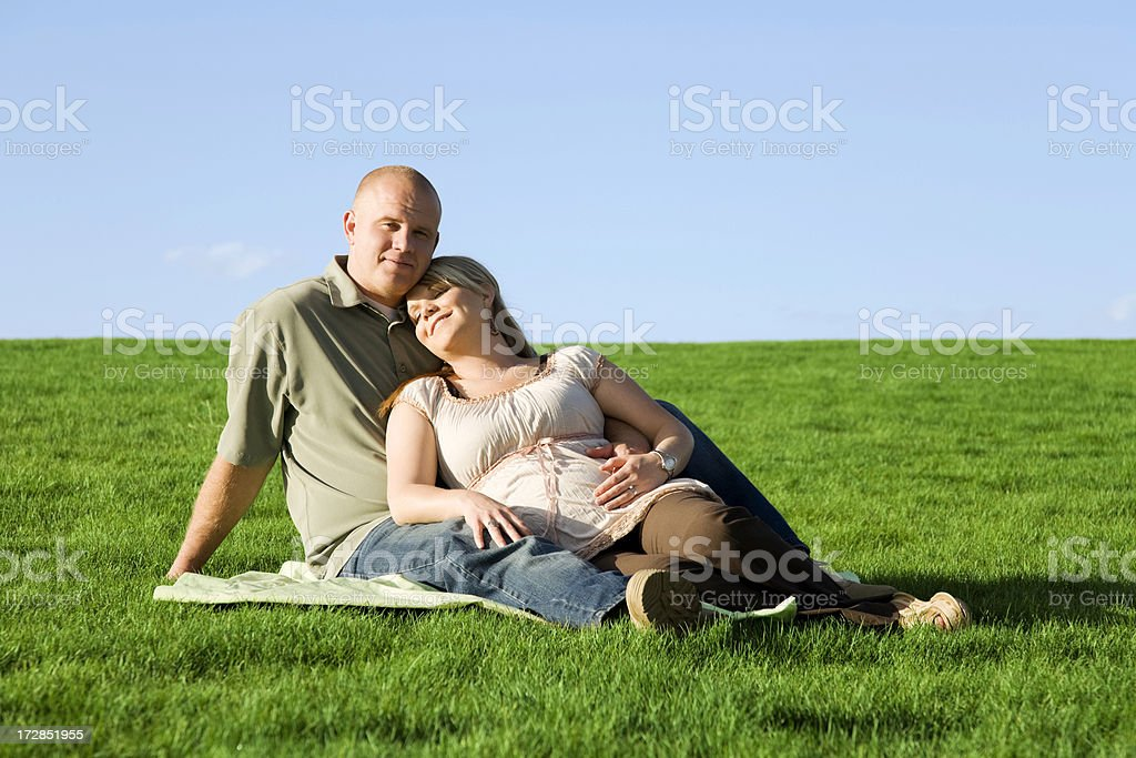 Pregnant Couple in The Park royalty-free stock photo