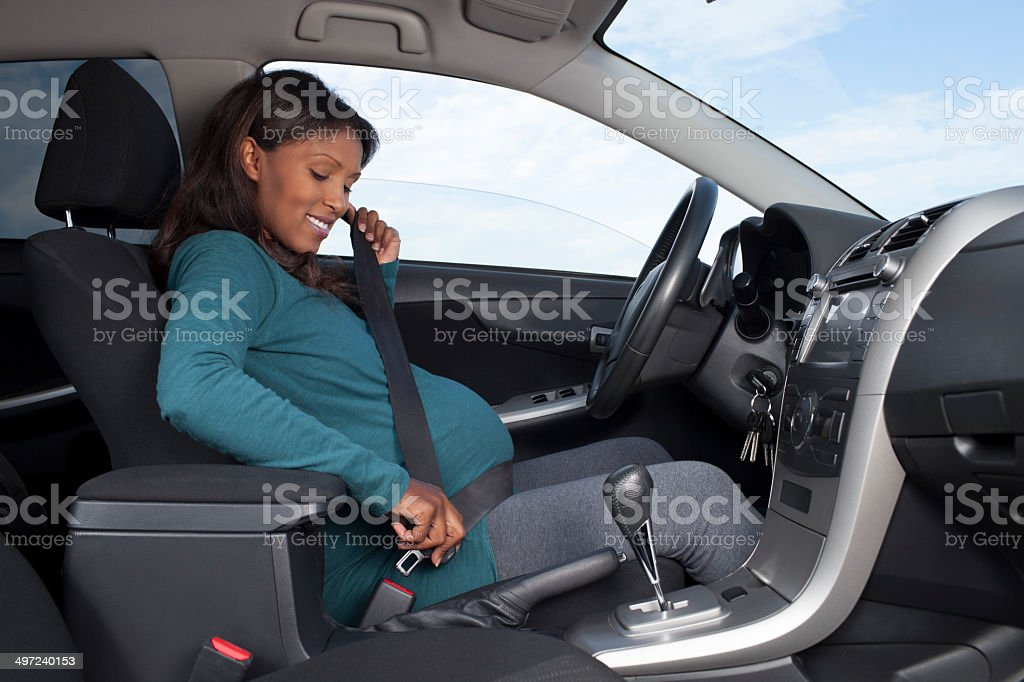 Pregnant Driver Safety. stock photo