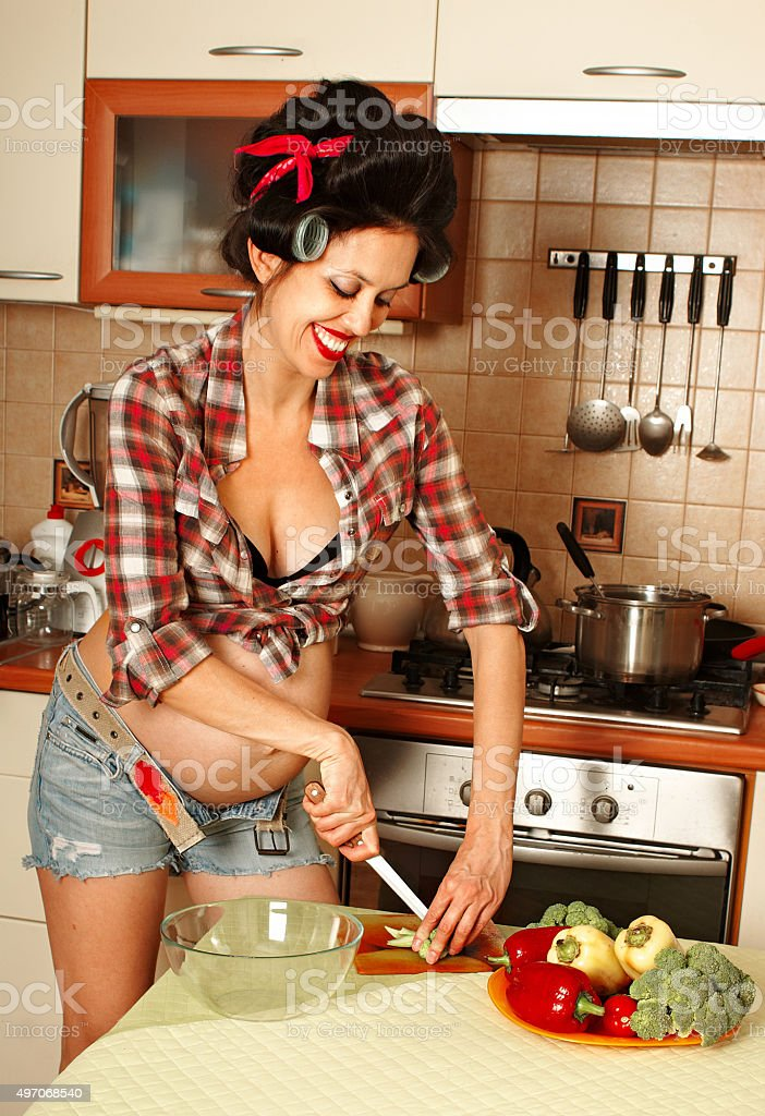 Pregnant housewife pin-up style stock photo