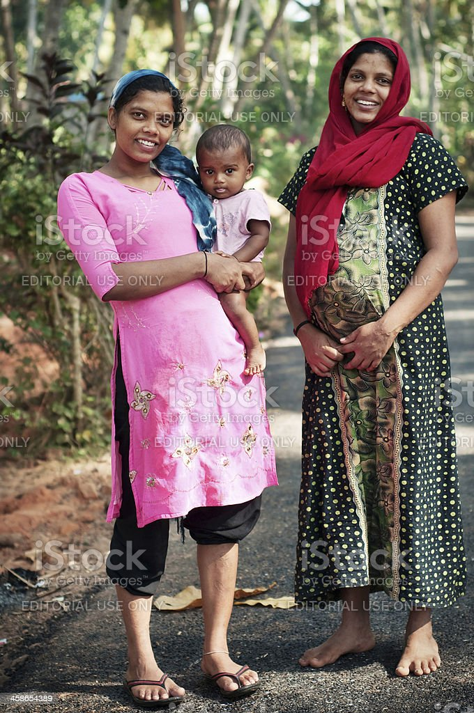 Pregnant Indian sisters with a child. stock photo