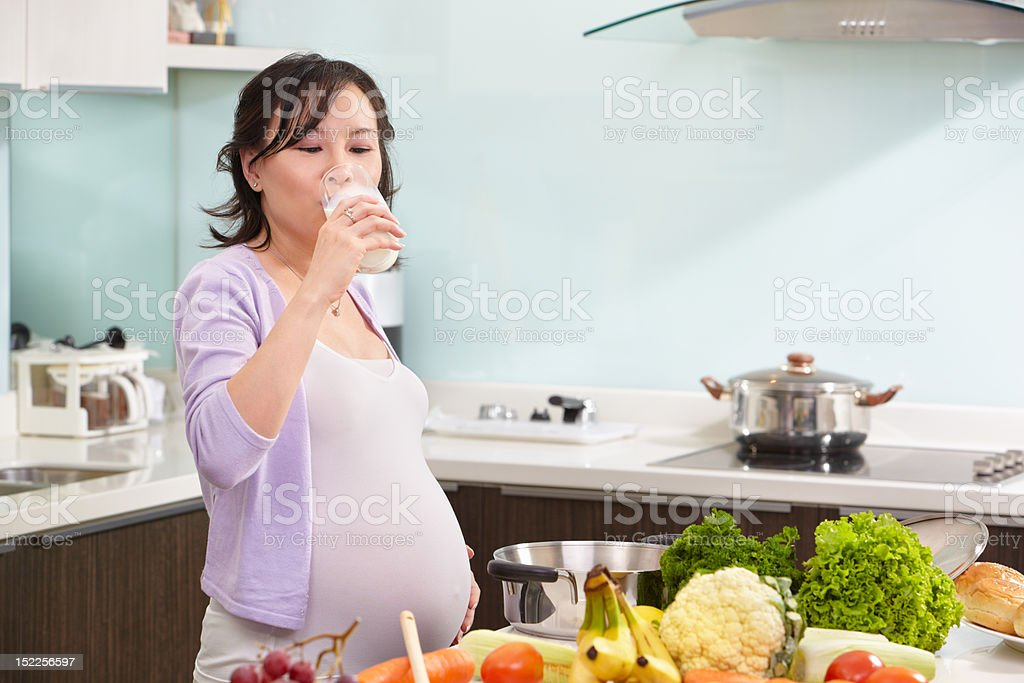 Pregnant lady drinking milk royalty-free stock photo