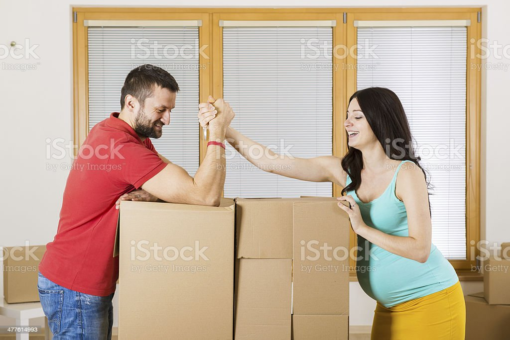 Pregnant mother and happy father in new house royalty-free stock photo