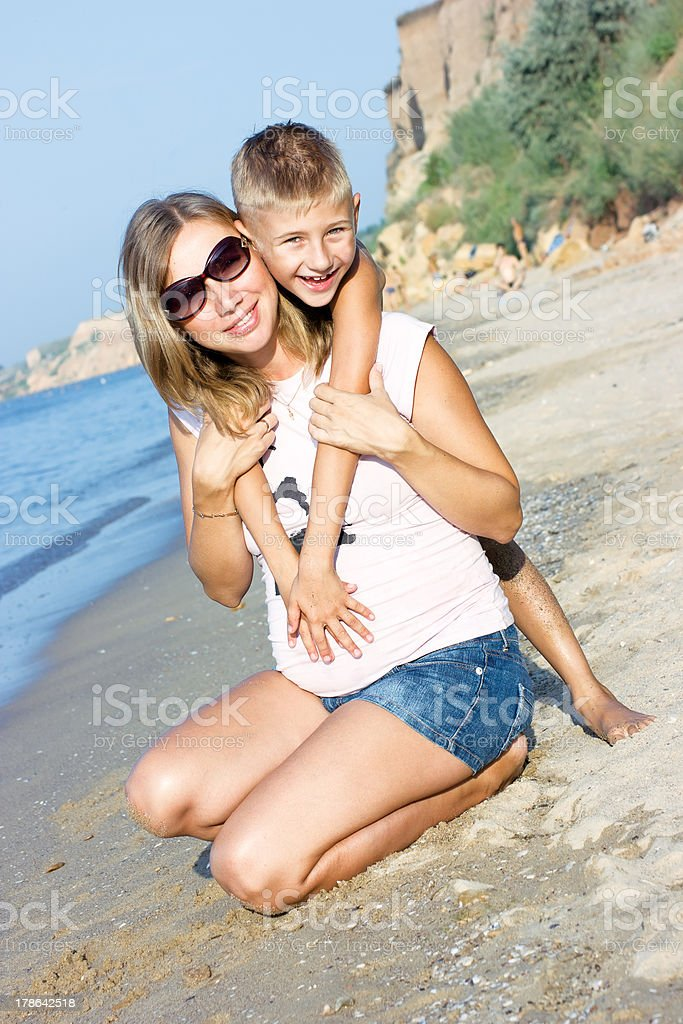 Pregnant mother and son hugging royalty-free stock photo