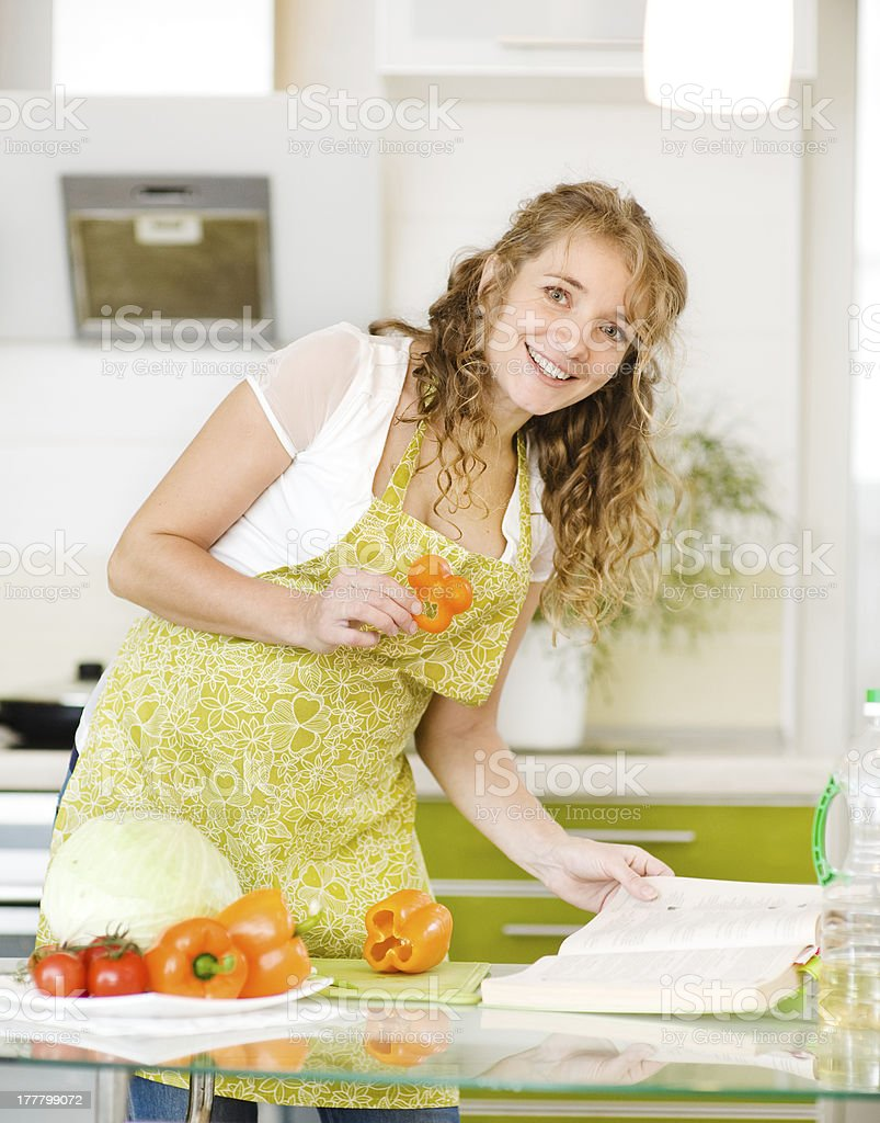 pregnant mother cooking in kitchen royalty-free stock photo