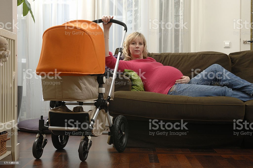 pregnant mother rocking baby stroller royalty-free stock photo