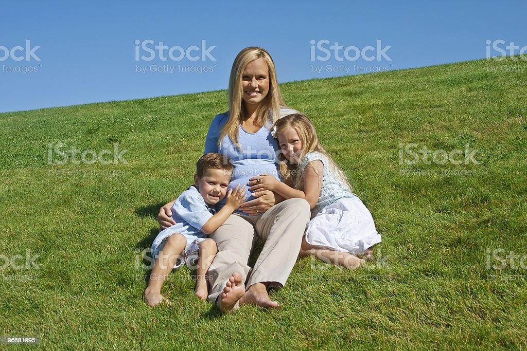 Pregnant Mother with her kids royalty-free stock photo