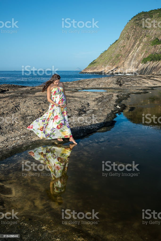 Pregnant wearing a formal dress looking at reflection royalty-free stock photo
