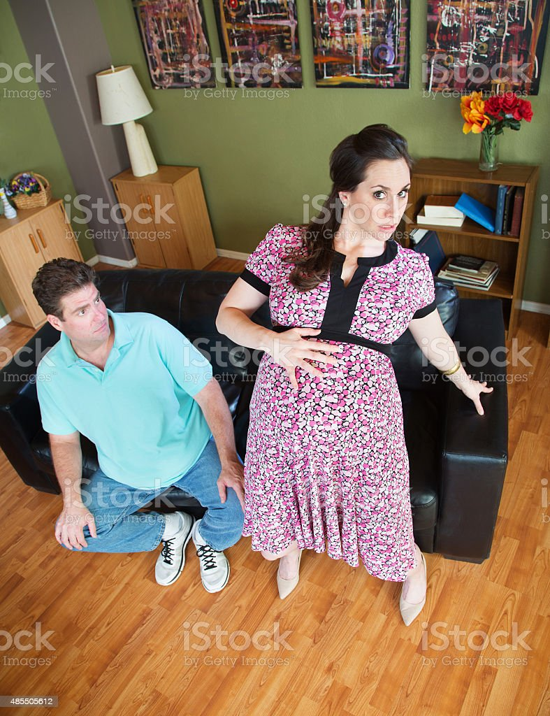 Pregnant Wife Getting Up stock photo
