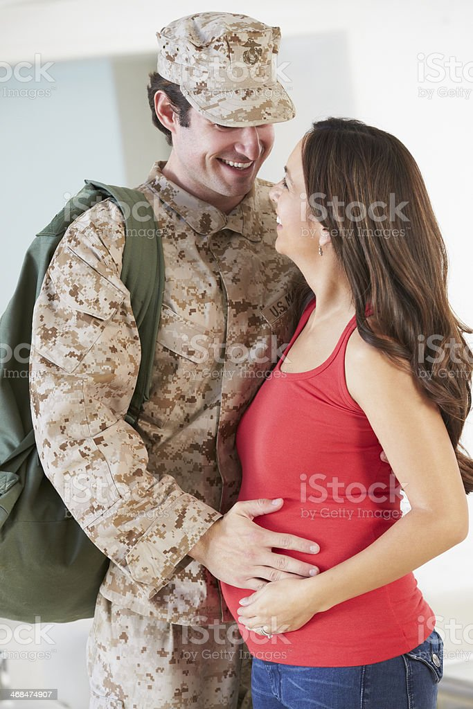 Pregnant Wife Greeting Military Husband Home On Leave royalty-free stock photo