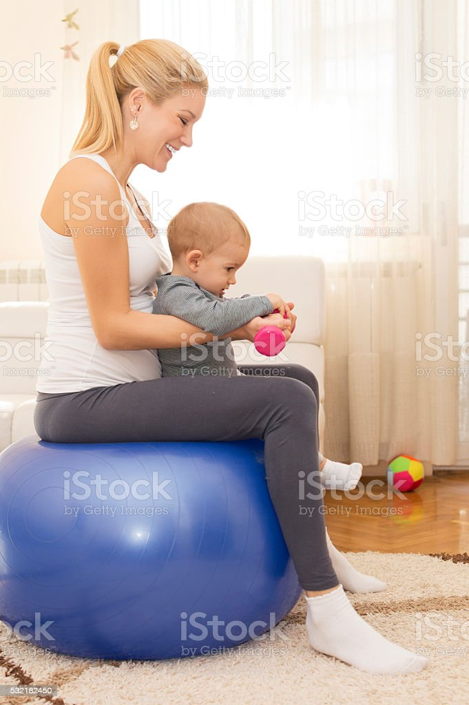 Pregnant woman and child exercising stock photo