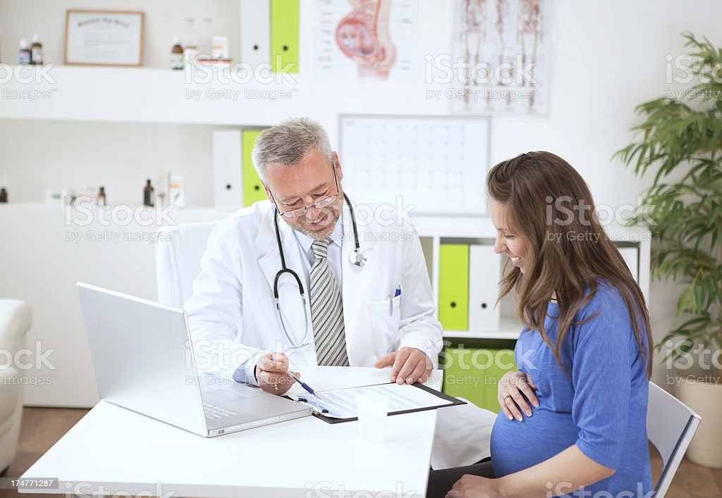 Pregnant woman at doctor's office. royalty-free stock photo