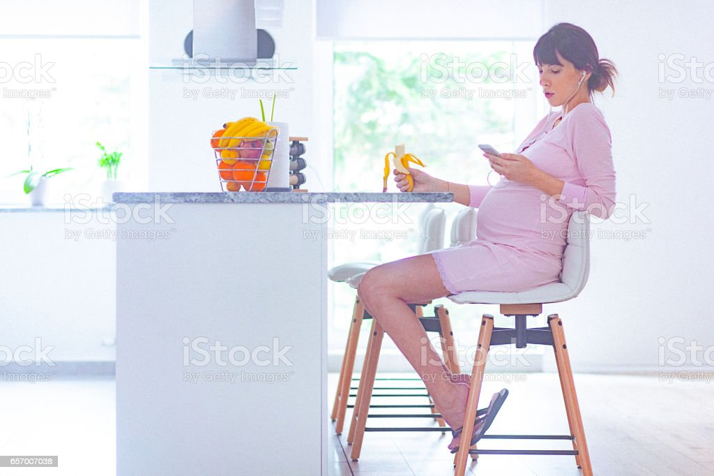 Pregnant woman at home in the morning stock photo