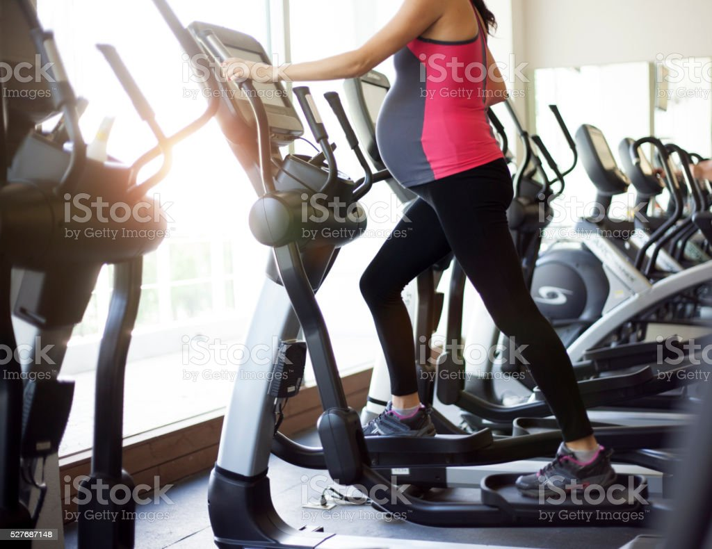 pregnant woman at the gym stock photo