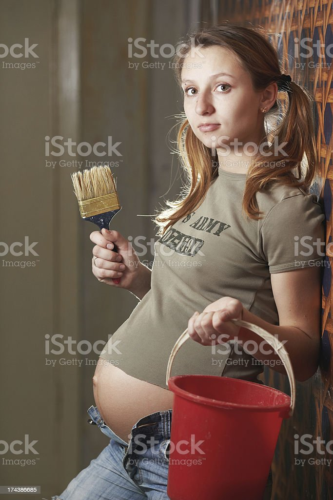 Donna incinta builder foto stock royalty-free