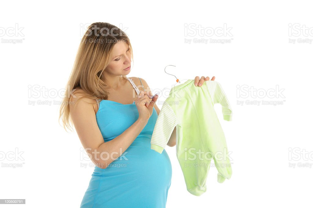 pregnant woman buying baby clothes royalty-free stock photo