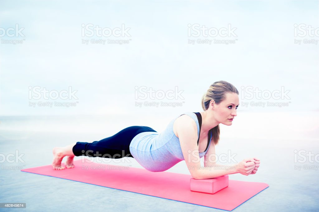 Pregnant woman doing fitness exercises stock photo