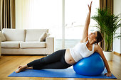 Pregnant woman doing pilates exercises
