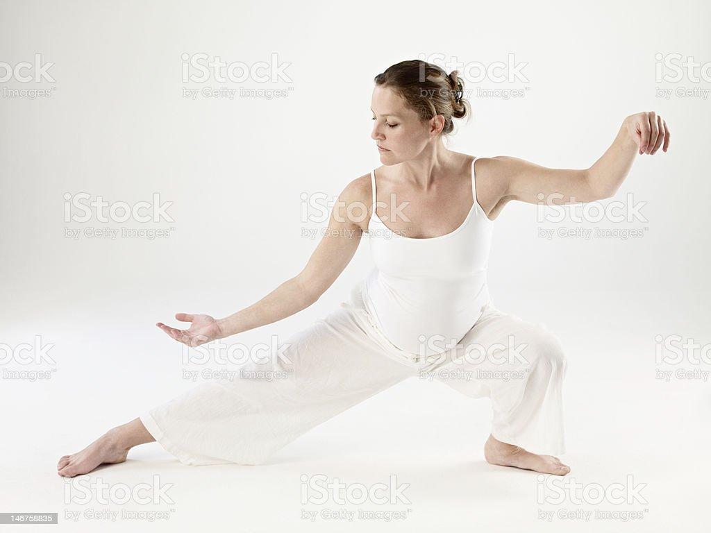 Pregnant woman doing Tai Chi stock photo