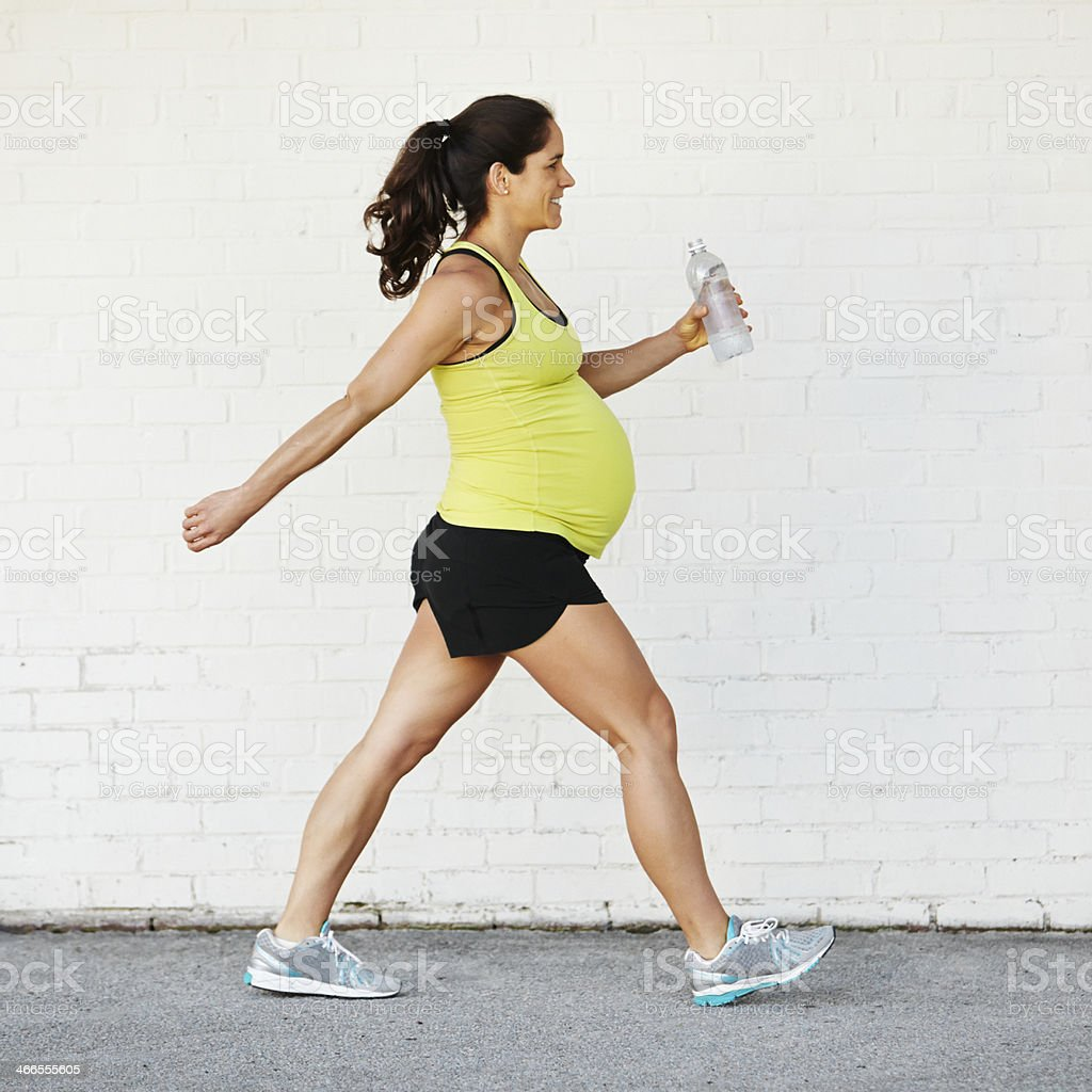 Pregnant Woman Excercising stock photo