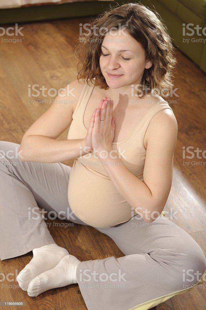 Pregnant woman exercising royalty-free stock photo