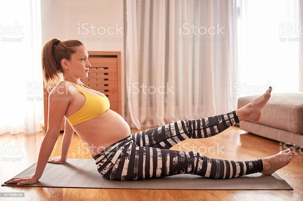 Pregnant woman exercising stock photo