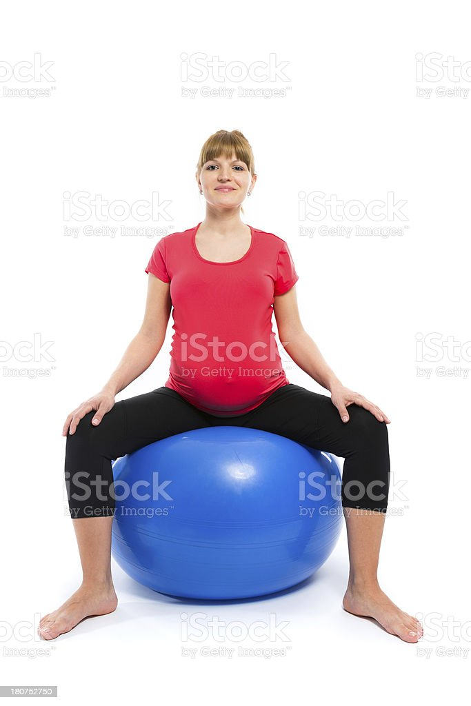 Pregnant woman exercising with fitness ball royalty-free stock photo