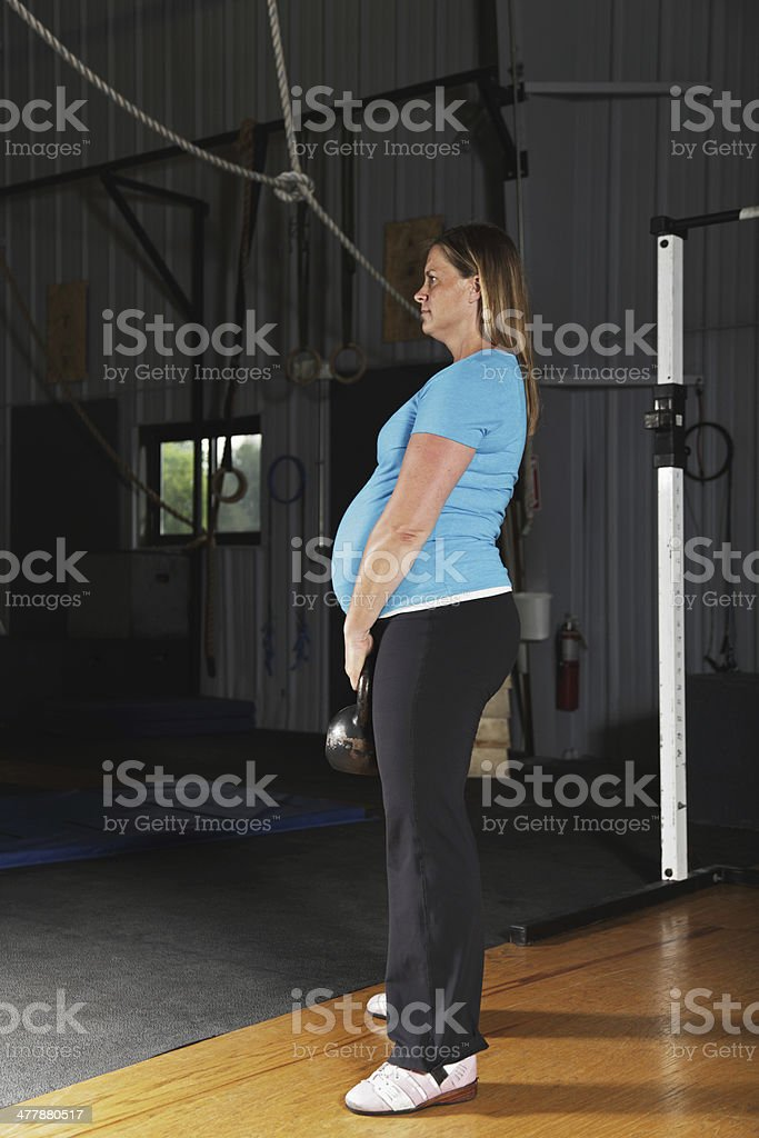 Pregnant Woman Fitness Exercise Workout Kettlebell Swing royalty-free stock photo