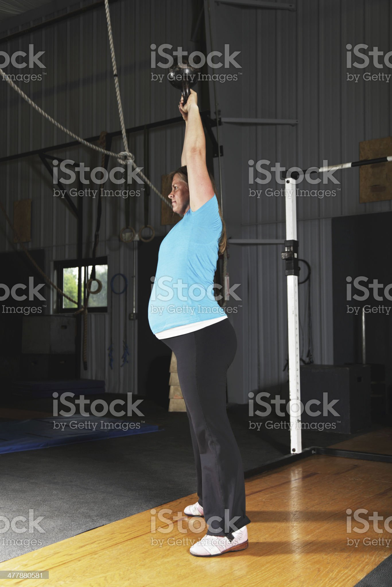 Pregnant Woman Fitness Exercise Workout Overhead Kettlebell Swing royalty-free stock photo