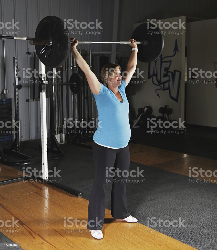 Pregnant Woman Fitness Exercise Workout Overhead Push Press royalty-free stock photo