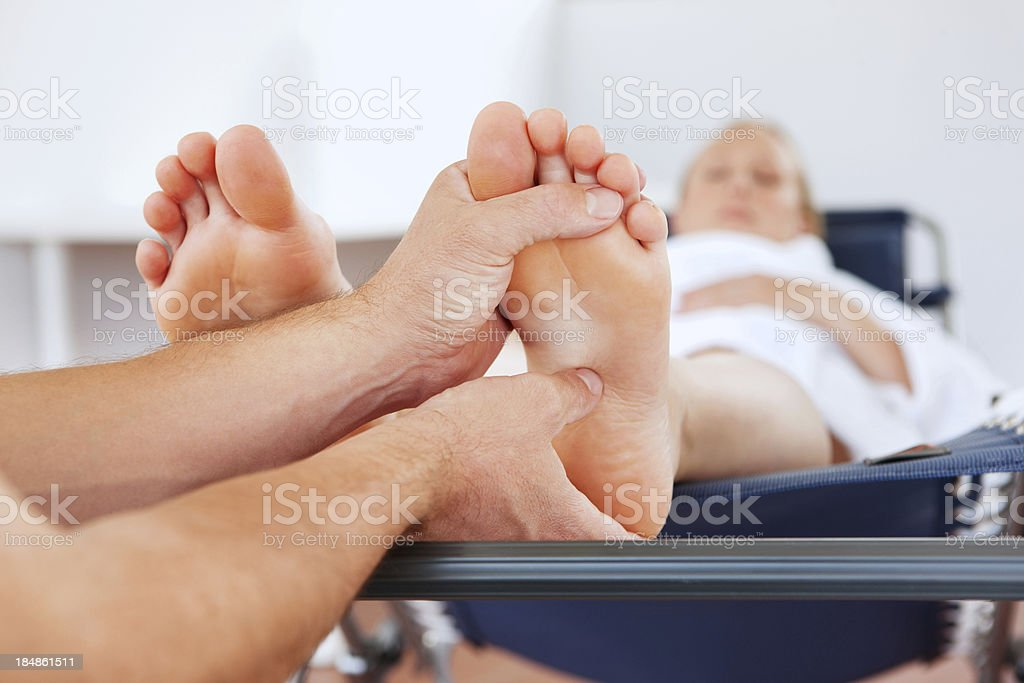 Pregnant Woman Getting a Foot Massage stock photo