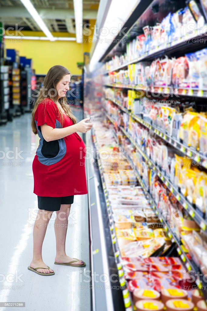 Pregnant Woman Grocery Shopping stock photo
