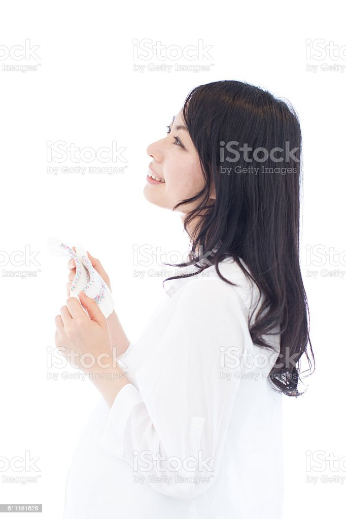Pregnant Woman having baby socks stock photo