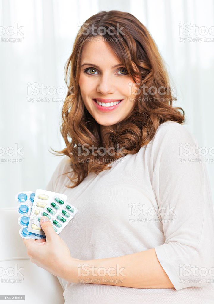 Pregnant woman holding vitamins royalty-free stock photo