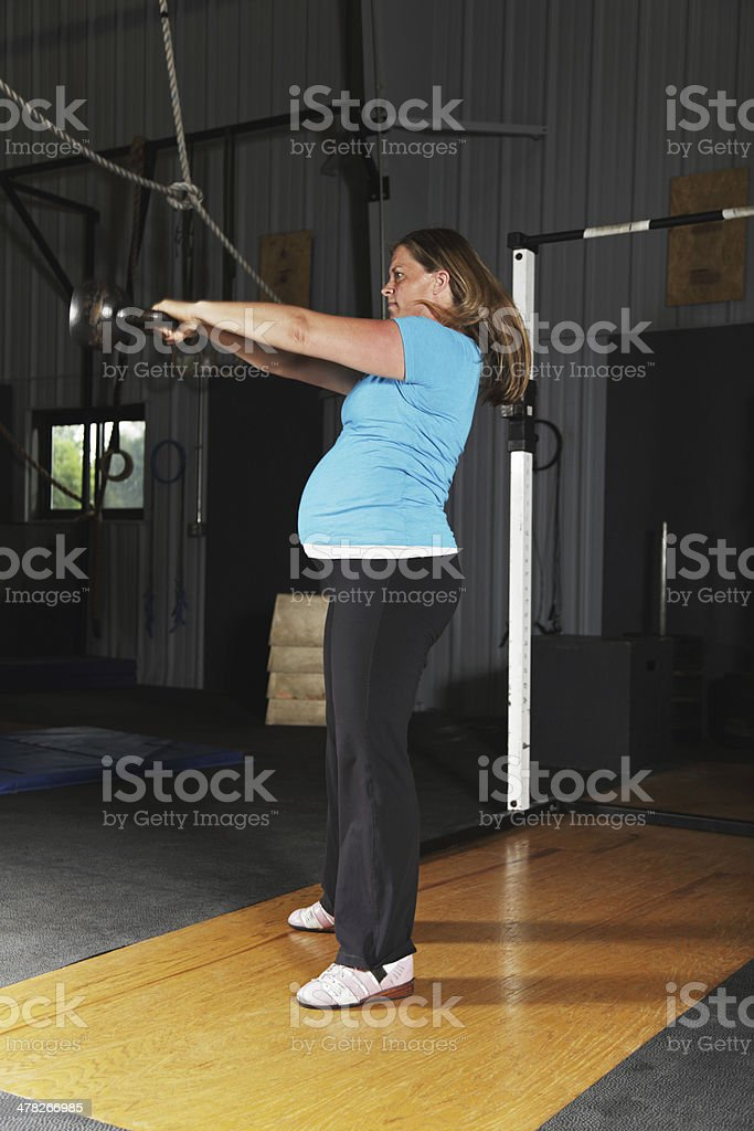 Pregnant Woman Kettle Bell Swing Fitness Exercise Workout royalty-free stock photo