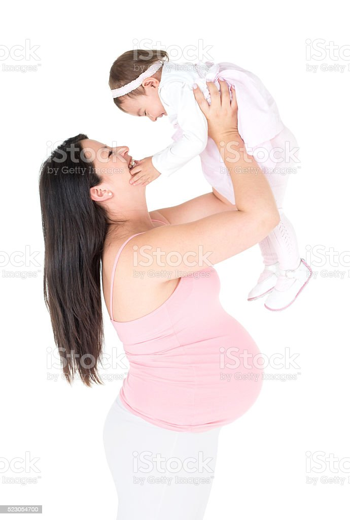 Pregnant woman lifting her child stock photo