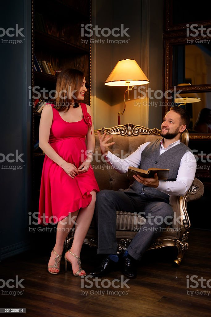 Pregnant woman listens to poems stock photo