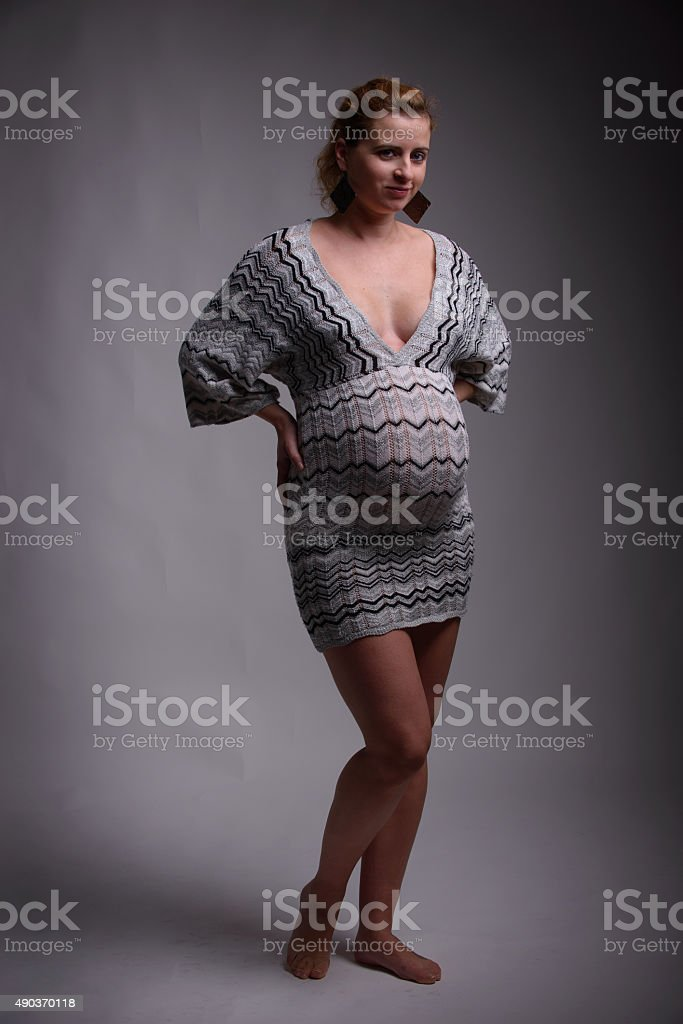 pregnant woman posing in studio stock photo