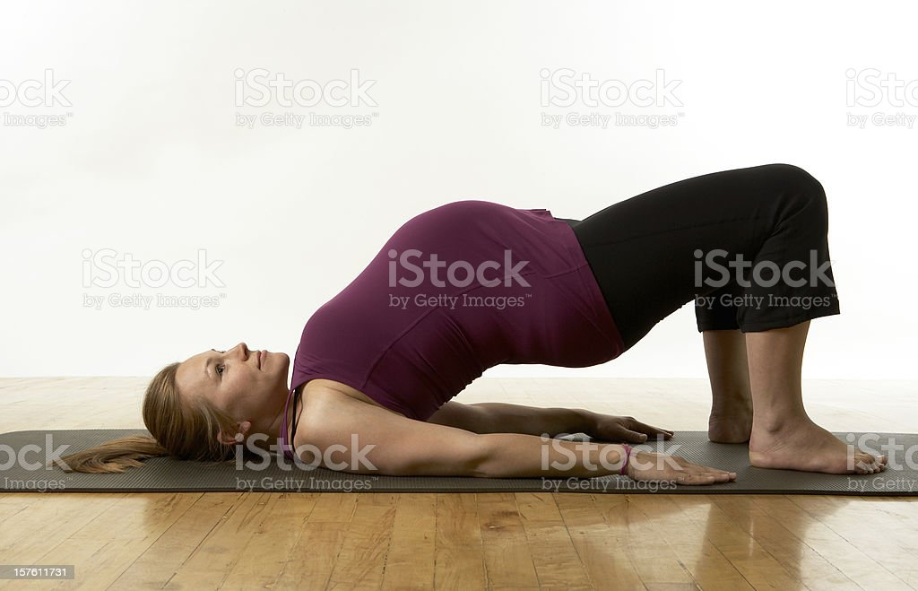 Pregnant Woman Practicing Yoga Bridge Pose On White. stock photo