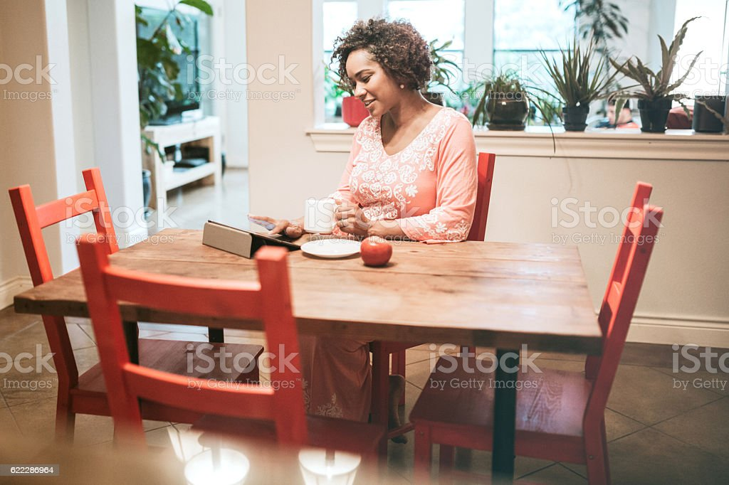 Pregnant Woman Reading Digital Tablet stock photo