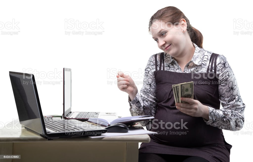 Pregnant woman showing fico gesture stock photo