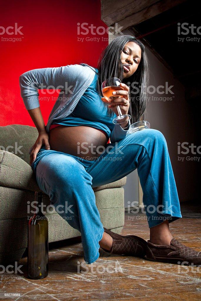 Pregnant Woman Smoking & Drinking royalty-free stock photo