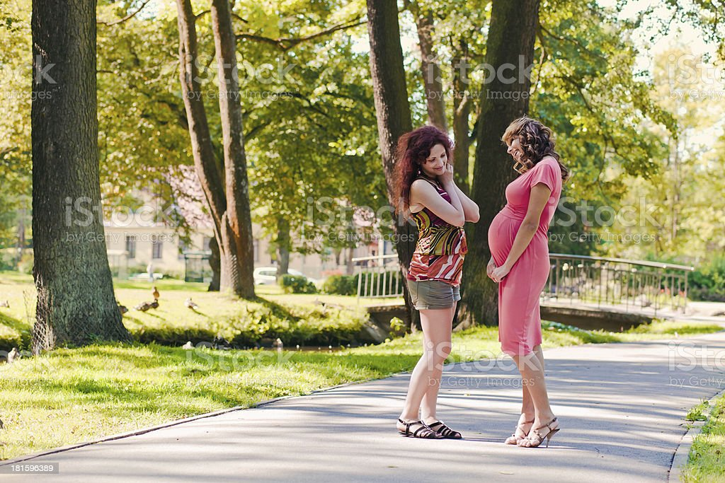 pregnant woman talks to the girlfriend stock photo