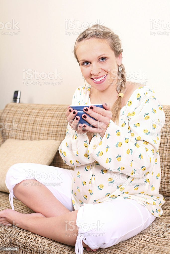 Pregnant woman with a cup of tea stock photo