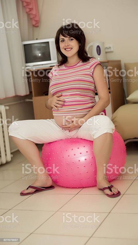 Pregnant woman with gymnastic ball. stock photo