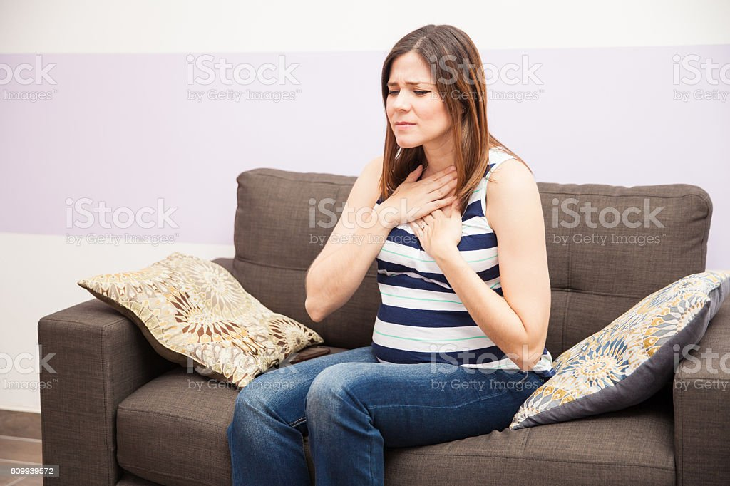 Pregnant woman with heartburn stock photo